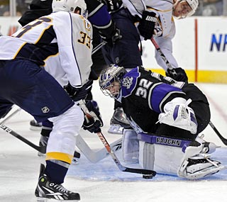 Nashville's Colin Wilson beats Los Angeles goalie Jonathan Quick for a goal in the third period.  (AP)