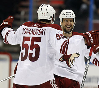 Phoenix's Adrian Aucoin, the fourth skater for the Coyotes in the shootout, nets the decisive goal. (AP)
