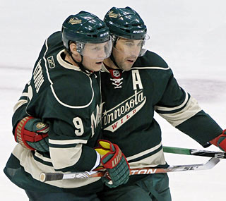 Mikko Koivu and Andrew Brunette help the Wild creep closer to the final playoff spot in the West.  (AP)