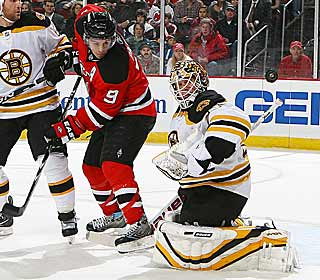Zach Parise flips the Devils' third goal of the first period past the Bruins' Tim Thomas. (Getty Images)