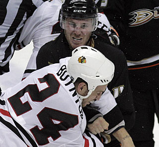 Things get ugly late when James Wisniewski fights a second time as he mixes it up with Nick Boynton. (AP)