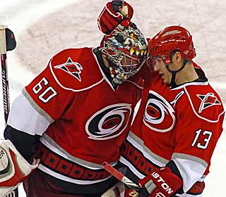 Ray Whitney is congratulated after his goal in overtime seals a win for the Hurricanes. (AP)