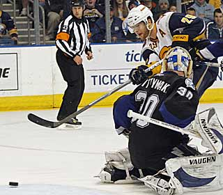 Behind Jason Pominville's hat trick, the Sabres climb to within four points of second place in the East. (AP)