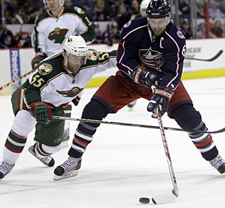 Back after a four-game absence due to injury, Rick Nash adds two goals for a total of 30 this season. (AP)