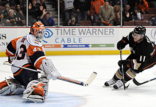 Saku Koivu takes the first and only shot in overtime to cap Anaheim's rally. (Getty Images)