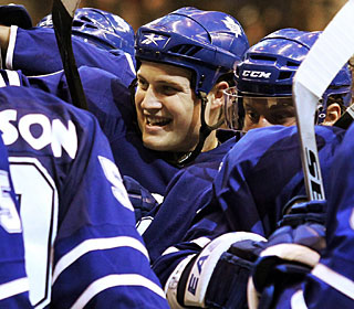 Nothing but smiles for John Mitchell and the Maple Leafs, who win for the sixth time in seven games. (AP)