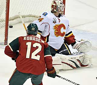 Chuck Kobasew scores twice, helping the Wild keep a faint pulse in the playoff race. (AP)