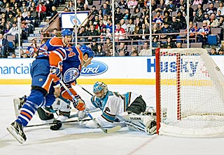 Fernando Pisani lifts the puck over Evgeni Nabokov and pushes Edmonton's lead to 3-0.  (Getty Images)