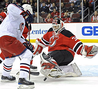 Martin Brodeur gets to the 40-win mark for the eighth time in his stellar career. (AP)