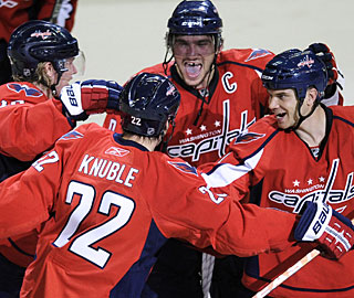 Alex Ovechkin, Mike Knuble and the Caps celebrate another win over Sidney Crosby and the Penguins. (AP)