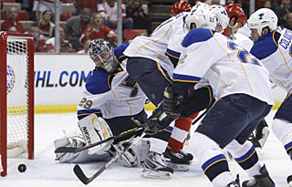 Neither Ty Conklin nor three Blues defensemen can prevent Todd Bertuzzi's tip from finding the net. (AP)