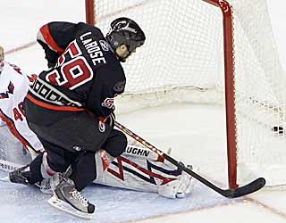 Chad LaRose's goal during the fifth round of the shootout seals a win for the Hurricanes. (AP)