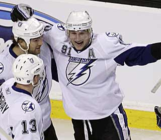 Steven Stamkos has a lot to celebrate. With two goals, he ties the league lead with 45. (AP)