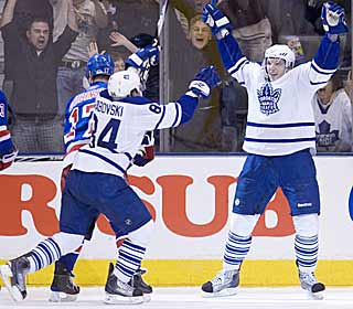 Nikolai Kulemin (right) starts the celebration after scoring the winner just 39 seconds into OT. (AP)