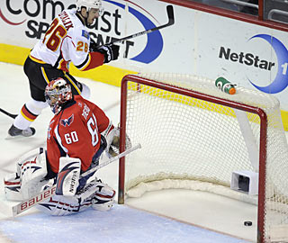 Ales Kotalik celebrates scoring the first of four Calgary goals in the opening period.   (AP)