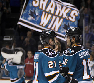 In the absence of the Sharks' leading scorer, Devin Setoguchi (right) does his part with two goals.  (AP)