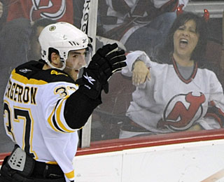 This Devilish fan clearly does not approve of Patrice Bergeron's winner, the only goal of the game. (AP)