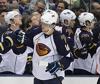 Thrashers teammates appreciate Nik Antropov doing some damage against his former team. (US Presswire)