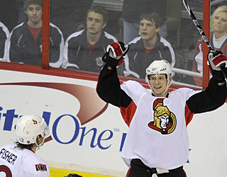 Jason Spezza's second power-play goal sends the game into overtime. (AP)