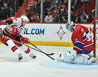 Eric Staal takes three shots on goal and gets one the 'Canes need by Carey Price. (Getty Images)