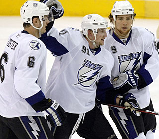 Steven Stamkos (center) and teammates celebrate the only goal the Lightning actually need. (AP)