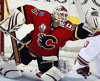 Miikka Kiprusoff keeps the Flames in the playoff picture with a 29-save effort vs. the Coyotes.  (AP)