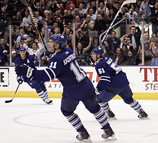 The Maple Leafs start celebrating Luke Schenn's goal, which turns out to be the winner. (US Presswire)