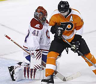 Jaroslav Halak uses all means -- including his face -- to stop all 35 shots by the Flyers. (AP)