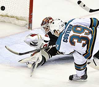 The Sharks' Logan Couture smacks in the game-winning goal, keeping the Wild out of the playoffs. (AP)