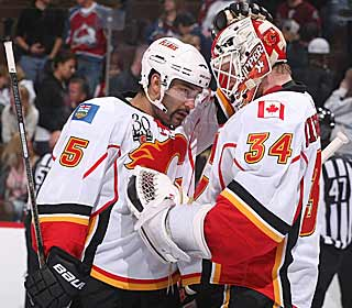 Nigel Dawes and Miikka Kiprusoff congratulate each other after an important win. (Getty Images)