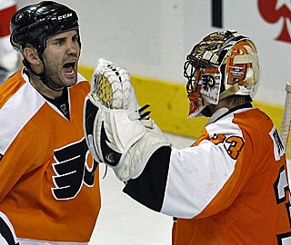 Ian Laperriere celebrates with goalie Brian Boucher after a victory the Flyers needed badly.  (AP)