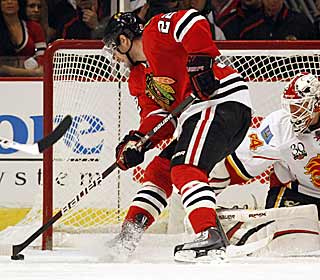 Troy Brouwer scores the second goal for Chicago, which is all it would need to beat Calgary. (AP)