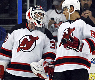 Martin Brodeur skates off the ice not only with his 600th win, but also his 110th career shutout. (AP)