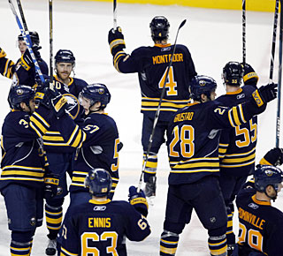 Sabres players celebrate winning their first Northeast Division title in three seasons.  (AP)