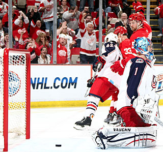Niklas Kronwall (top) scores Detroit's first goal and helps set up the second. (Getty Images)