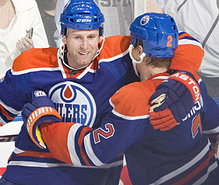 Ryan Whitney is congratulated by Aaron Johnson (2) after scoring the winning goal. (Getty Images)