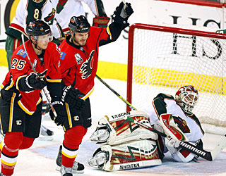 David Moss and Ian White celebrate Nigel Dawes' (not shown) goal, but Calgary misses in the SO. (AP)
