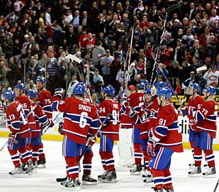Even though they lost, the Canadiens wave to their fans after making the playoffs. (Getty Images)