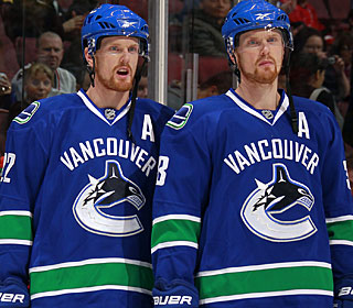 Daniel (left) and Henrik Sedin come up with major production for a combined eight points. (AP)