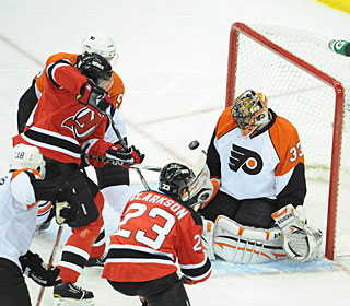 Brian Boucher makes one of his 23 saves in his first playoff start in eight years. (US Presswire)