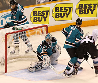 Tough luck for the Sharks in the final minute when the puck deflects off Rob Blake in the net. (Getty Images)