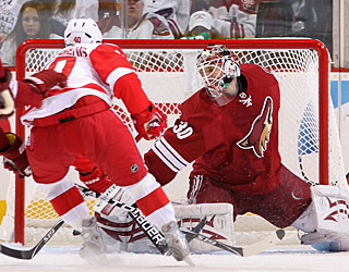 Henrik Zetterberg puts the first of his three goals past Ilya Bryzgalov. (Getty Images)