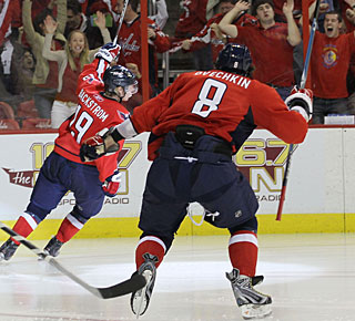 Alexander Ovechkin chases after Nicklas Backstrom, who just gives Washington a big win with his third goal.