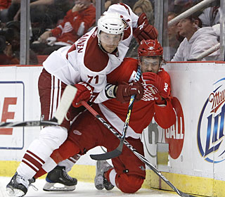 Petteri Nokelainen and the Coyotes get the upper hand on Henrik Zetterberg and the Wings.  (Getty Images)