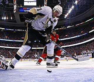 Evgeni Malkin grabs a loose puck in the crease and scores his third goal of the playoffs. (Getty Images)