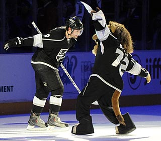Kings mascot Bailey congratulates defenseman Drew Doughty on his four-point evening.  (US Presswire)