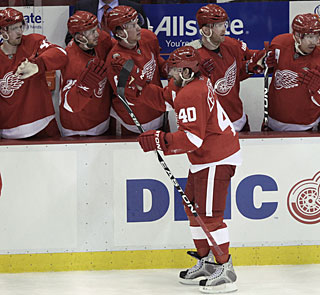 With two more goals, Henrik Zetterberg (40) takes his playoff total to five markers. (AP)