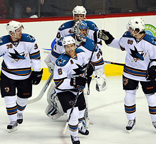 Joe Pavelski (8), goalie Evgeni Nabokov and mates skate off after a hard-earned win. (US Presswire)