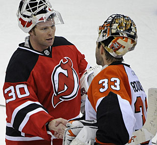 After doing battle for their respective teams, Brodeur and Boucher meet for the traditional handshake. (AP)