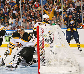 Adam Mair (right) gets his first goal when his shot goes in off Tuukka Rask's skate. (Getty Images)